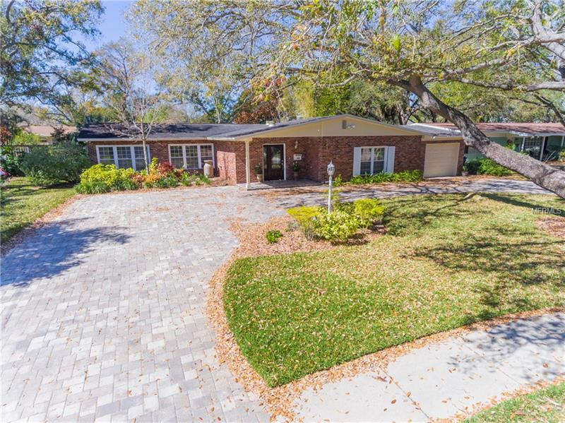 """Remarkable opportunity, to own an OVER SIZED DOUBLE LOT in SOUTH TAMPA - BEACH PARK. This charming Mid-Century Modern/Ranch style pool home sits on two separate lots (.32 acres), and has been fully renovated with 4 bedrooms and 4 full bathrooms. The open floor plan boasts exquisite bamboo and tile floors throughout the home, custom built in cabinets, and a large Florida room with full bathroom and custom Murphy bed. Enjoy a chefs dream kitchen, complete with gas cooktop, 42"""" cabinets, walk-in pantry, and gigantic stainless steel appliances. This open kitchen concept spills over onto two separate areas for entertaining. Experience the true Florida lifestyle from the Florida/Sunroom, which overlooks your massive private back yard with an oversized saltwater pool and paver patio. The spacious master bedroom suite includes a luxury bathroom with heated whirlpool tub and spacious walk-in closet. This home is practically new with many upgrades completed recently: New garage flooring 2018, New Wine Fridge 2017, New HVAC 2016, New Gas Hot Water Heater 2016, New Slope Roof 2016, New Paver Patio 2016, New Privacy Fence 2013, Double hung low e-windows 2010, and the list goes on and on… This neighborhood is very family friendly, and lovely for walking close to the water, shopping, downtown Tampa, Westshore Business District, and MacDill Air Force Base."""