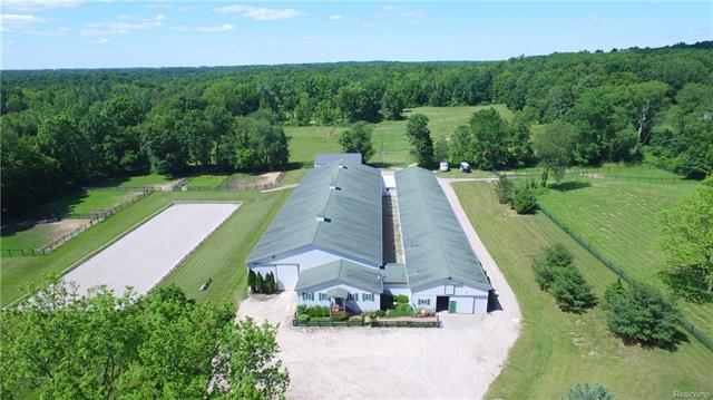 Click Virtual Tour link to watch video! Now priced BELOW appraised value! Situated on 40 acres, this world class facility is loaded with state-of-the-art amenities. The barn boasts a 66x220 indoor arena with German Geo Textile footing and Euro sprinkler system. There are 33 12x12 matted stalls w/ large dutch-style windows, automatic fly-control system, and brick paver aisle. Grooming stall w/ infrared heater & central vac system. Hot water wash stall w/ infrared heater. Heated tack room w/ private lockers. Observation room features a kitchenette, heat and a/c. Full bathroom and large office. Sound system throughout barn, arena and observation room. Separate 40x60 equipment and hay barn w/ lifted floor. This stunning property features 2 large pastures, 9 smaller pastures, 9 paddocks, RAMM fencing, sprinkler system, and a 66x200 outdoor arena. Recently remodeled home offers 2,364 sq ft, 3 bedrooms, 1 bath, dining room, living room, and fireplace.