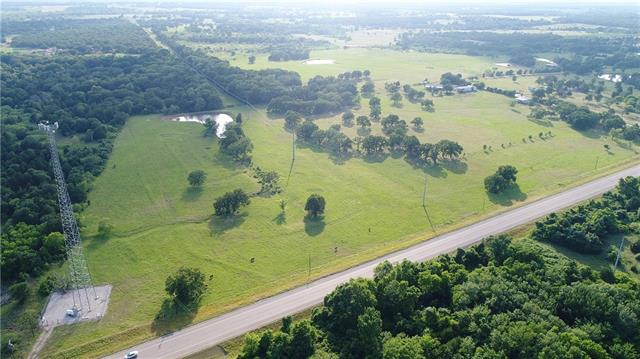Beautiful 26.881 acres has large scattered trees located near the back half of the property. Wonderful stock tank ready for fishing and family time. Electricity and water are available. Additional 15.317 acreage MLS#3406197           is available to purchase as well.  Currently being used for cattle. Home and out buildings located on adjoining 38.26 acres MLS#9371140 for sale as well. A MUST SEE!!