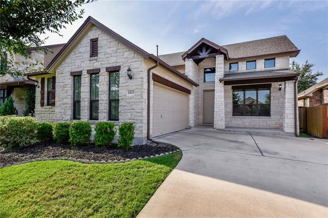 Beautiful, immaculate Pearson Brothers at Avery Ranch home awaits your visit.  This stunning home boasts a very modern grey finish and upgrades galore. Rich hardwood floors can be found throughout the main living areas of the home into the master bedroom. Kitchen is an open concept with stainless appliances, granite, and upgraded lighting. Master bath has been outfitted with floor to ceiling tile and has his/her sinks, garden tub, and stand up shower. Back patio has been extended for entertaining.