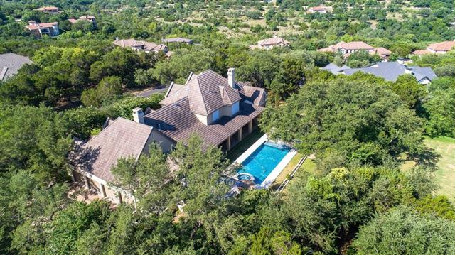Rare opportunity in Arbolago. This hidden gem of a neighborhood is now offering a true estate home on 1 acre in the heart of Lakeway. Features a large covered back patio that spans almost the entire width of the home overlooking the pool, bocce ball court, chess set, outdoor kitchen, arbor, and gardens. Entertainment styled floor plan that flows from the chef's kitchen into the family room and large breakfast area. Double ovens, built-in refrigerator, gas cook top, & custom cabinets. Lots of built-ins!