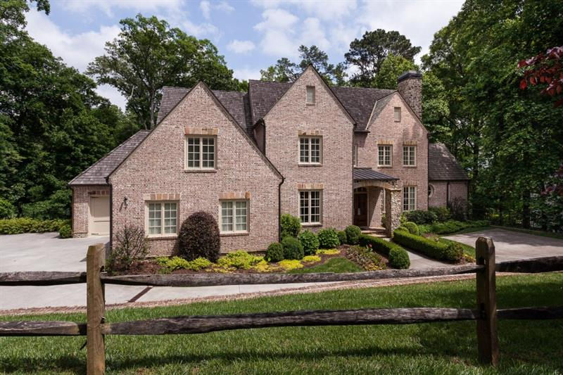 Exceptional Bill Baker des home in prime Buckhead loc! Refined Country French architecture w/ quality vintage appts incl heart of pine flooring, reclaimed beams, elegant moldings, custom woodwork.  Custom kit open to GR, Master on main, spa bath. Huge sec BR's w/ ensuites. Fin ter level w/ high ceilings & ample add sq ft for add expansion. Lg private lot, an ideal place for a pool, outdoor kit & FP. Convenient to priv schools & Brandon Elem.  Min to bus districts, medical facilities, all thoroughfares.  Proven high rental cash flow, great investment opp!
