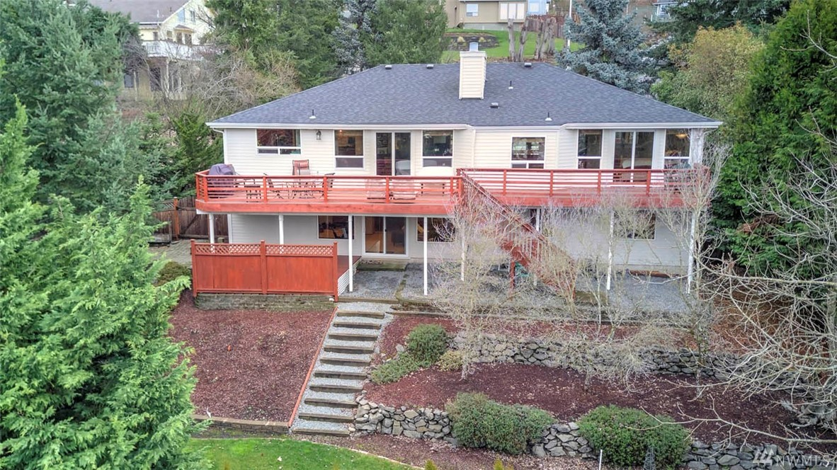 Gorgeous 4bed/3bath/+den view home! Remodeled w/chef's dream kitchen, granite & ss appliances. Enjoy gleaming HW floors, vaulted ceilings, huge deck & lg windows. Glorious master suite w/spa-like bath & deck access. Master suite + 1 bedroom on main. Craftsman trim.  Full basement w/2 guestrooms, den, huge recroom, bar, walkout to hot tub. High efficiency furnace/A/C/newer roof. Beautiful yard w/estab. landscaping. Commuter dream w/freeways, train, airport, retail, dining & business hubs.