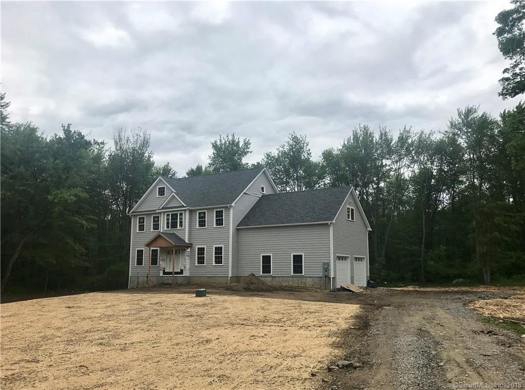 House is up, still time to customize finishing touches... New construction on west side Danbury! 9 foot ceilings, hardwood floors and open floor plan. Designer kitchen with granite counters, center island and SS appliances. Family room with gas fireplace and hardwood floors. Formal dining room with built ins. Main level office/library or formal living room. Large master bedroom with gorgeous en suit bath and two large walk in closet plus 3 spacious bedrooms on second floor and laundry room. Attached 2 car garage, mud room, walk-in pantry and so much more. Beautiful deck overlooking great back yard and potential extra sqft in lower level for expansion. Great opportunity to own new construction in established area. Convenient location with easy access to I-84 & I-684 and all area amenities.