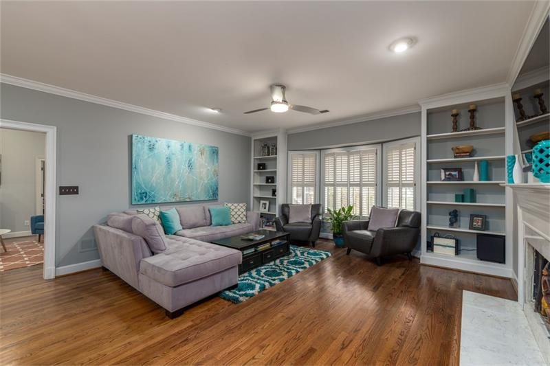 Enormous family/great room with beautiful bay window & built-in bookshelves!