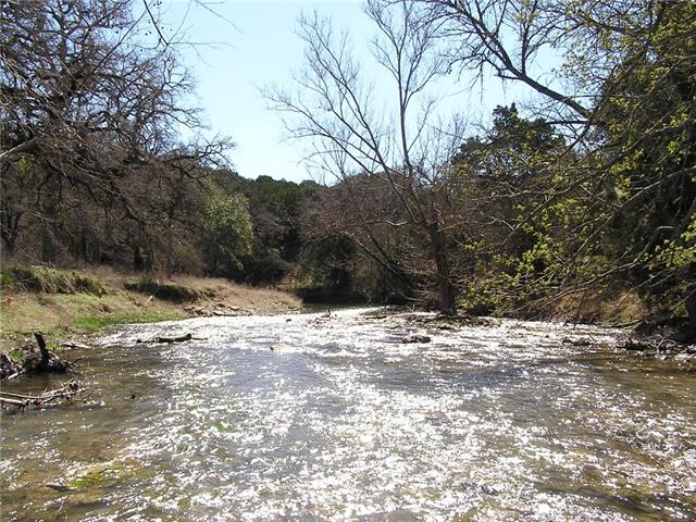 Beautiful stretch of the San Gabriel River / Russell Fork - both sides of the river!  A lot of history in this old family farm.  A 2,200 square foot house overlooks a pecan bottom in the bend of the river.  River crossing to a hill with views and a spring fed creek.  Massive live oaks and grafted pecan trees.  A second house on property, 1,120 sq.ft. with 2 bedrooms/1 bath.  Fields w/improved grasses. Hunting, cattle, horses or whatever you like.