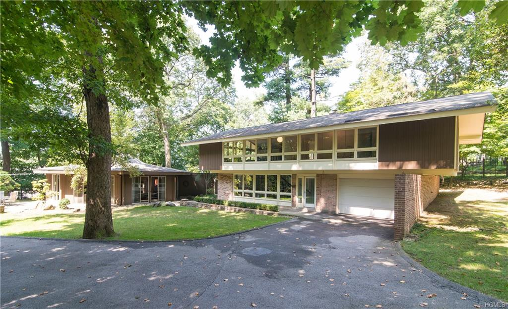 Welcome to 330 Clinton Avenue, a One-of-a-Kind Mid-Century Modern Home