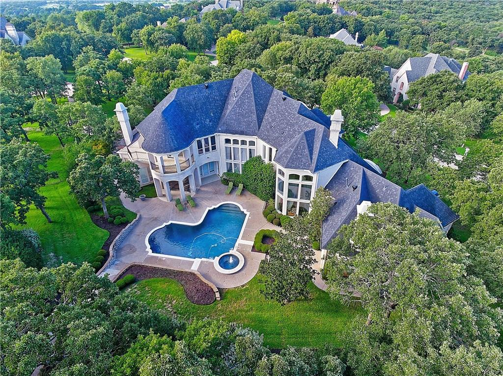 Located on 1.8 heavily treed acres in guarded & gated Tour 18.