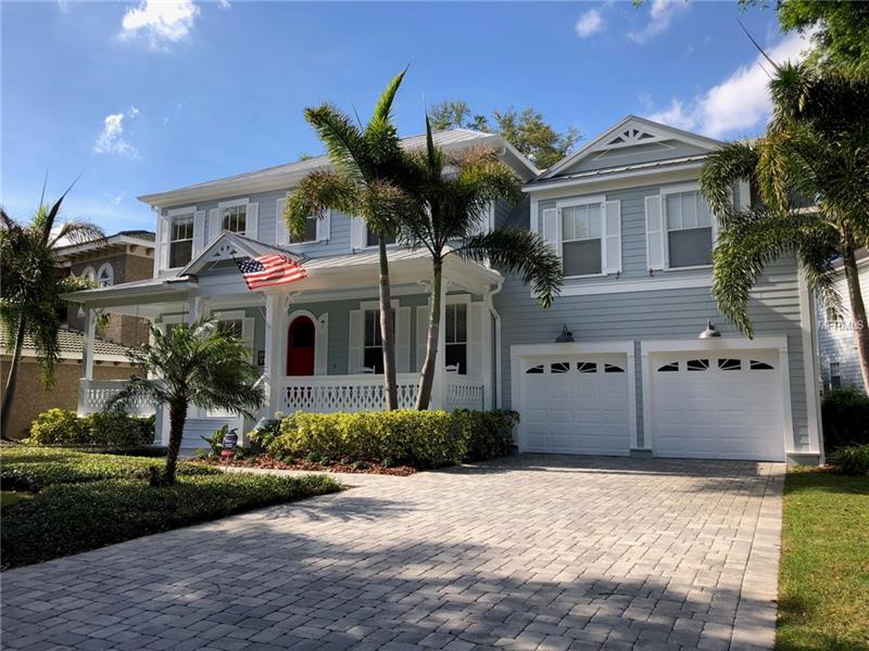 This waterfront Key West style home has a timeless Florida look with warm, custom features nestled in a quiet