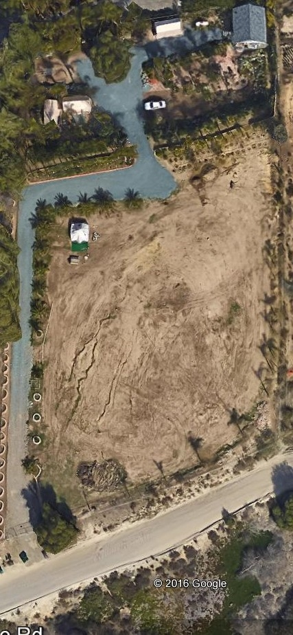 """Prime 2.19 acre lot on Guajome Lake Road with views of Guajome Lake and Park.  Horse Property with access to trails in adjacent Park!  Possible sub division.  Water Meter on property and 3/4"""" lines water beautiful landscaping.  Existing Non permitted 360 sq. ft Out Building/storage in rear of property. Relax in aesthetic tranquil garden or have awesome garden parties with family and friends!"""