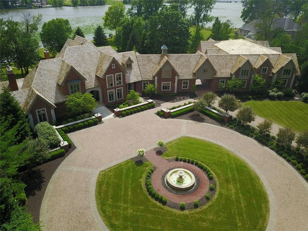 Pass through the gated entry and soak in nearly 5 majestic acres. THE RESIDENCE boasts commanding waterfront views of Geist Reservoir, a distinctive floor plan, decor & architectural elements that raise the bar for extraordinary luxury estates. From the cigar/ bar lounge, stunning theater rm, multiple entertaining areas, a caterer's kitchen,  7 bedrooms, 3rd floor guest wing, an elevator, 8 full/ 5 half baths & space for 34 cars, THE RESIDENCE leaves a lasting impression of fine estate living.