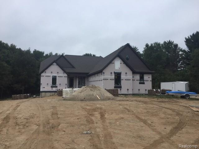 New Year-New Home.  This home will be completed in 60 days.  Come take a look, you will not be disappointed. Oakland Twp Custom F-Floor Master on approximately 7.7 acres with huge pines & beautiful hardwoods, no wetlands, gravel driveway. Gourmet kitchen w/Lafata cabinets, large island, SS appliances and 2 story great room. Master suite w/2 walk in closets, study or home office. Upstairs one bedroom features full bath & WIC, bedrooms 2 & 3 have a Jack & Jill bath, daylight basement, covered porch off nook.  4 car garage.  Licensed MI Real Estate Agent must be present at all showings.