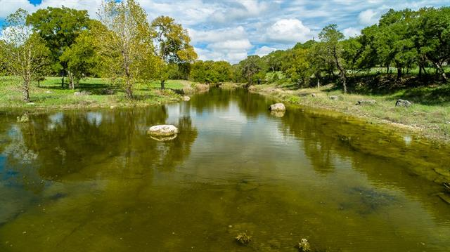 +/-3600' of flowing, spring fed Rebecca Creek encompass this unrestricted ranch offering situated approx. 35 mins. to San Antonio, just 1 hr to Austin. +/-115 gently rolling acres boast gorgeous hardwoods, long range Hill Country views, +/- 1932 sqft 3/2 ranch home, +/- 1555 rocked casita with a cozy chink logging interior and fireplace overlooks the sparkling waterway. Charming historical barns, +/-3200 sqft metal workshop, +/-1500 sqft garage, +/- 25 ac pasture, and complete privacy. Wildlife exempt.