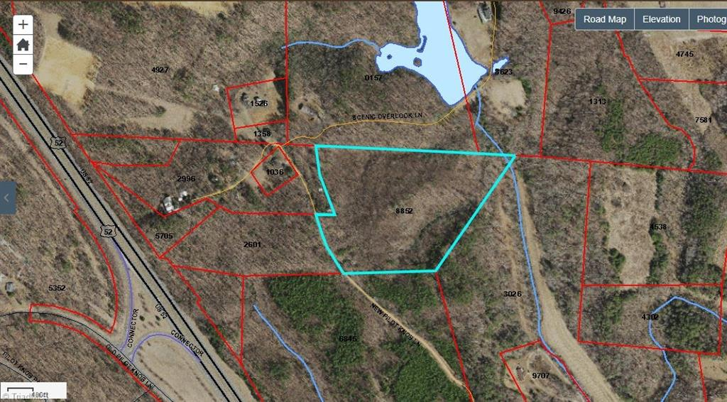 L-2061.  Very nice wooded tract with overall good topography. Located at the base of Pilot Knob just off US 52/I 73-74 in Pilot Mountain  in the heart of the Yadkin Valley and only minutes from the Blue Ridge Mountains in Virginia. Nice stream along the southeast corner of the property