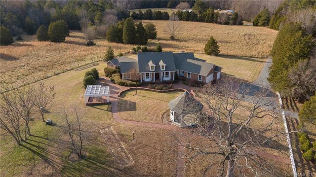 Custom built estate on a picturesque 20 acres in gated community & minutes from desirable downtown Waxhaw!  Main house is over 3000 sq ft, Barn w/3344 sq.ft, Cottage w/989 sq.ft., with high finishes & appliances throughout.  Bkfst area overlooks beautiful pasture perfect & serene setting.  2 gazebo's and fenced pasture ready for horses.  Also on property a finished barn with large entertainment space, kitchen, bedrooms & workspace.  Barn boasts high end custom finishes.  Guest cottage on property has all the charm with high ceilings and shiplap.  There are also two other small buildings on property one great for fun or entertaining and other for workshop.  Plenty of storage with barns & garages!  This property is truly breathtaking and a must see to appreciate all of the finishes and beauty of the property.
