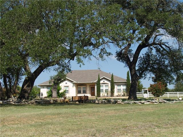A beautiful piece of quiet hill-country-living property in a gated community. Comfortable custom home, large oaks in a beautiful, peaceful gated community in Liberty Hill/Bertram area. In-house office, Jack and Jill bath connects bedrooms, well-house with deep well, fencing throughout the property, antique barn including electricity and water, work room, large storage room, tack room and covered area for animals.  Horses on property.  Hot Electric Fence. Check Attachments for Gate Code.