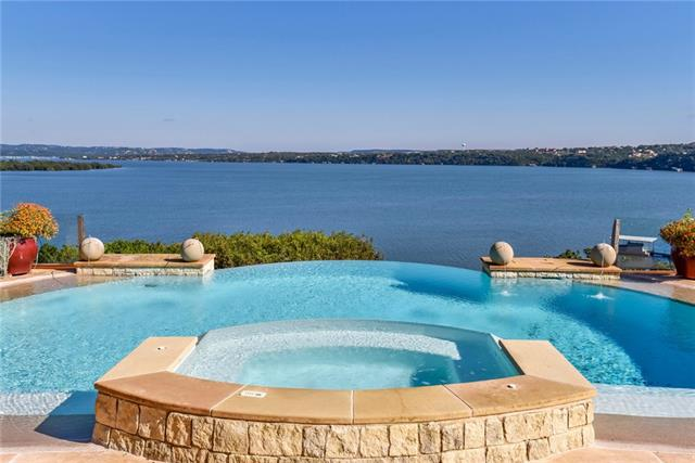 Nestled on the shores of Lake Travis, this inviting, private estate welcomes you like an exclusive island resort. This waterfront retreat provides a respite with an infinity pool seamlessly spilling into panoramic lake views & multiple outside entertaining areas. Resting on over 2.3 acres of luscious grounds, this prestigious home is situated on appx. 170' of private waterfront, complete with a boat dock/tram car, expansive windows, multiple courtyards, media room, custom wine wall.
