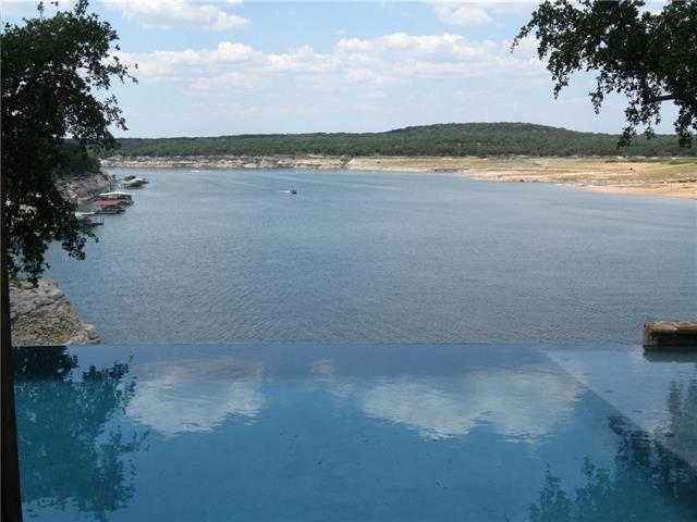 Spectacular, one-of-a-kind waterfront property. Contemporary, gated estate in gorgeous private setting next to Lago Vista Golf Club with over 180 ft of deep water Lake Travis frontage. Beautiful negative edge pool, outdoor entertainment area overlooking panoramic views of the lake and surrounding Hill Country. Gotta see this one - nothing like it on the north shore. Larger than tax records after remodel Call first for gate code.