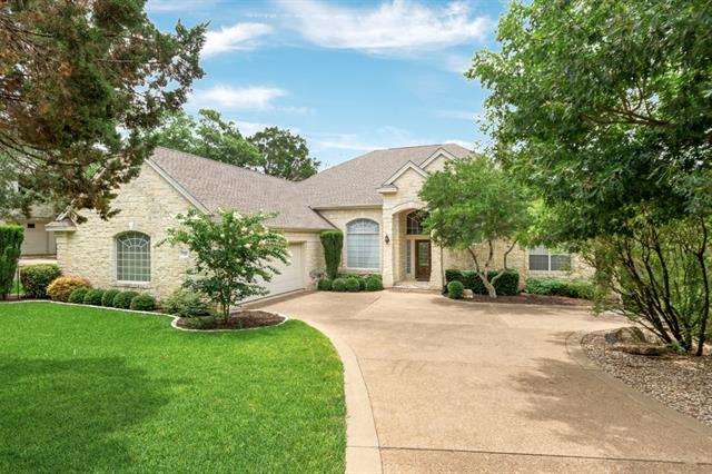 Beautiful Limestone exterior home sitting on large golf course lot with views of Yaupon Golf Course, this home is shielded by lots of trees and features a magnificent floor plan. Two bedroom suites downstairs and two upstairs. Open floor plan with lots of windows allowing for natural lighting. Island kitchen with tile counters, breakfast bar and lots of storage and counter space. Crown molding throughout, jetted tub, his and hers closets and the list goes on and on!