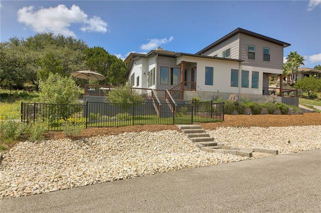 Designed to maximize the gorgeous lake & hill country views with a great deck & pool! Lots of big windows, tall ceilings, & beautiful finish-out. Spacious great room w/ bio-ethanol fireplace, gourmet kitchen w/ quartz & granite countertops, & custom made cabinetry. Living, kitchen, utility, & guest bedroom & bath on main level. Five steps to master suite. Master suite w/ view of pool and lake. Second staircase takes you to 2nd level w/ 2 beds & 3rd bath. 5 min walk to lake & park!