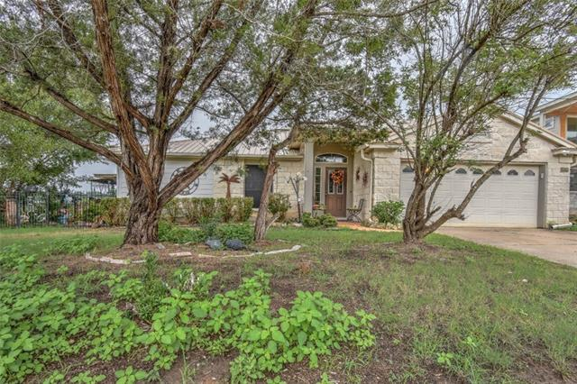 Beautiful views of the Texas Hill Country from both inside and outside of this wonderful home. The office/study can serve as a 4th bedroom. Truly amazing outdoor space is great for parties and entertaining, and yes, the hot tub conveys to the buyer as part of the sale. Located in the heart of Lago Vista and close to the golf course, private waterfront parks and tennis courts! The lot next door, which helps protect the views, is also available for sale