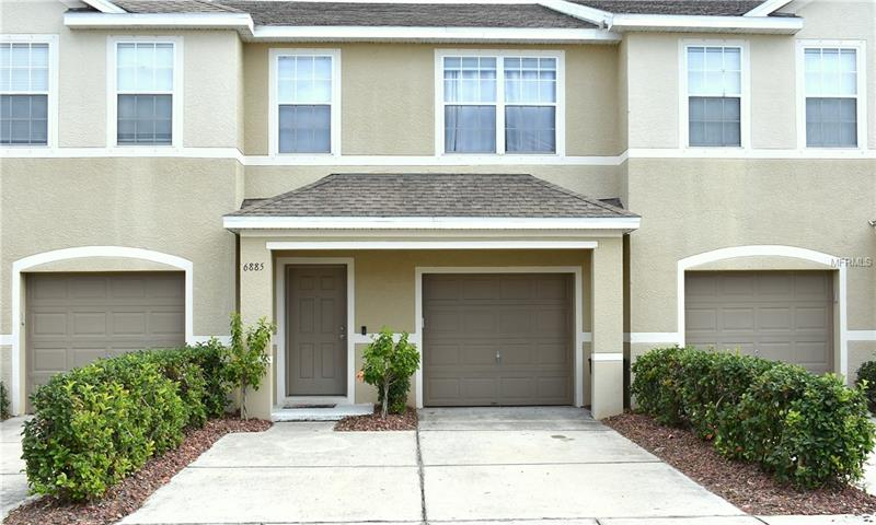 """Gorgeous townhome has been updated throughout. This home is truly """"Move-in ready""""! A warm and inviting foyer welcome you home.Amazing open floor plan features large kitchen with breakfast bar. All new Stainless steel appliances, solid surface counter tops and beautiful cabinetry. The Dining room is off the kitchen and perfect for sit down meals. Or if you prefer causal dining, the breakfast seats 4! Living room features a sitting area and opens via sliders to the screened patio. Contemporary wall units accent the Living room and are large enough to accommodate most TV's. Rounding out the first level you'll find a half bath. Upstairs you'll find 3 bedrooms and 2 full baths plus a lg. inside utility room. Master bedroom has a walk-in closet large enough to set up an office. The en-suite bath is luxurious: dual vanities, private water closet, large walk-in shower and of course you can relax your cares away while enjoying a soothing bubble bath in the separate tub. Guest bedrooms are separated from the master bedroom by the 2nd full bath and laundry room. Both guests bedrooms are highlighted by the Florida sunshine as the light dances across the rooms. There is a one car attached garage and two parking spots behind it. Community features one of the nicest pools in the city. There is a covered porch area with tables and chairs to relax when your'e not swimming. Conveniently located to shopping, bus and more. Short drive to I275 for travel to Tampa of downtown St. Pete. And about 20 mintues to the Gulf beaches."""