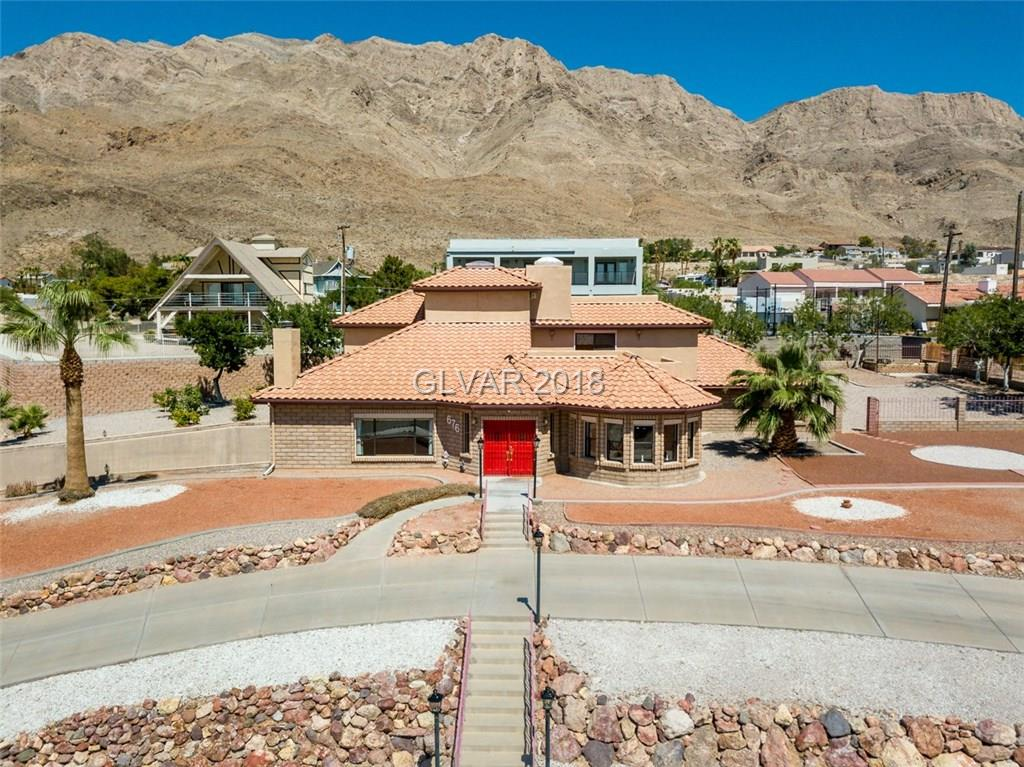 ONE-OF-A-KIND! BUILT LIKE A BOMB SHELTER WITH COMMERCIAL GRADE MATERIALS, BUT LIVES LIKE A PALACE. DID YOU SEE THE GARAGE? 15 CARS, OVER 3,500 SQUARE FEET OF WORKSHOP, STORAGE, AND PARKING SPACE FOR EVERY TOY AND HOBBY YOU DESIRE. CORNER LOT OVERLOOKING THE ENTIRE LAS VEGAS VALLEY FROM TWO BALCONY VANTAGE POINTS. UPSTAIRS MEETING/GATHERING SPACE YOU COULD HOLD A CONVENTION IN OR RUN YOUR BUSINESS. TOO MUCH TO LIST! CALL TODAY.