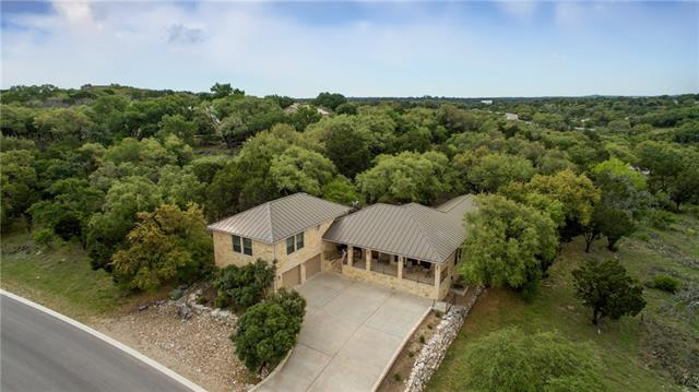 Gorgeous home with views for miles! Perfectly perched with views of the lake, relax on the expansive front balcony and watch the boats go by. Extraordinary finishes and attention to detail throughout this quality custom home. Enjoy single level living in this functional floor plan with the master just a half stair up. The backyard is a Hill Country private oasis, cool and shaded by large native oaks.