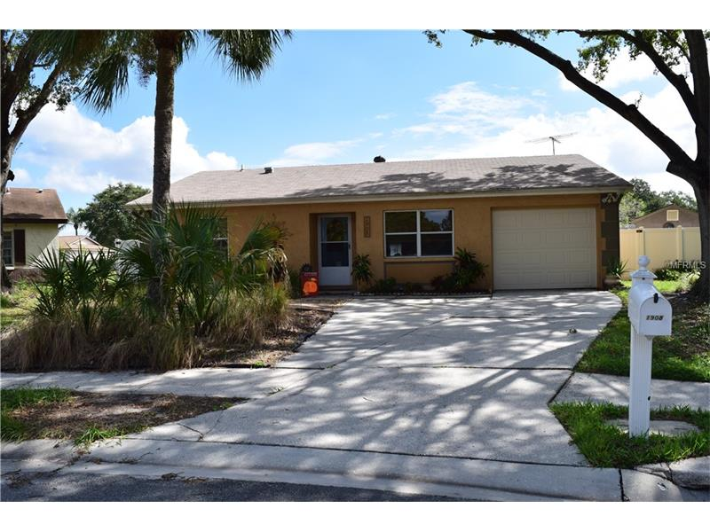 """Very nice move-in ready 1,629 SF home on cul-de-sac, a large pie-shaped yard that has a 134 ft rear property line. This home originally built as an efficiently planned, concrete block 2 BR, 2 BA, has a 20' x 30' addition which can be used as a 3rd BR/living area, artist studio, home office or combination thereof.  This huge bonus space has a mini-split unit, 2 exterior doorways (one each side), lots of windows, a closet & endless possibilities. The beautiful leaded glass front door welcomes you into the bright living room w/ large front window. Dining area adjacent to the inviting  kitchen w/ nice appliances. Attractive wood laminate flooring in living rm, dining rm, kitchen, & hall. Both bedrooms & bonus rm have carpeting, both baths have tiled floors. The 13' x 11'8"""" master BR is freshly painted, has mirrored closet doors, an updated private bath. The hall bath is also updated, adjacent to the 13' x 9'10"""" 2nd BR, which also has mirrored closet doors. Roof approx. 10 years old, water heater and washer new this year. FEMA FIRM flood zone X - no flood insurance! Huge back yard features enough open space for a soccer game or an amazing garden, a double gate entry on north side, white PVC fenced sides, a separate enclosed area with a wooden storage shed & cement slab. The back 40' of the lot is a designated drainage easement with underground pipe. Great neighborhood close to AMC Woodlands, shopping/dining/Starbucks. Easy commute to Tampa or airports. Oldsmar has numerous parks, rec facilities, splash park."""
