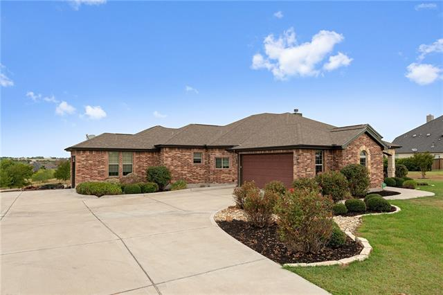 """Custom Builder's own wonderful brick and stone home featuring perimeter 2x6 insul. walls, all 10'or 12' ceiling heights. Delightful bright, contemporary walls and lighting combined with gorgeous """"baroque""""-style FP and guest-bath vanity.  Spacious dark walnut hand-scraped lam floors..plush carpeting at bedrooms, ceramic  at baths.  Granite counters at kitchen+ all bathrooms.  Mas.Bath jetted tub + spacious walk-in shower. Full bath+2dressings serve two guest BRs. Lofty panoramic views from back patio/deck!"""