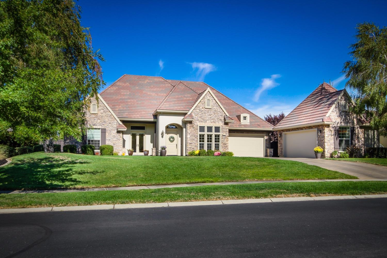 Morgan Creek Single Story Custom! This home exudes pride of ownership! Pristine inside & out! This home sits on a nearly 2/3 acre fully landscaped lot on the 5th fairway. Home is 3589 sq. ft. with 4 beds & office or 5 beds, 3.5 baths,master suite with exercise/sitting room and 4 car garage! Travertine floors, granite, stainless appliances, central vac, freshly painted outside and more! Beautiful views of golf course & majestic oaks! Enjoy the walking trails along the creek! Come live the dream!