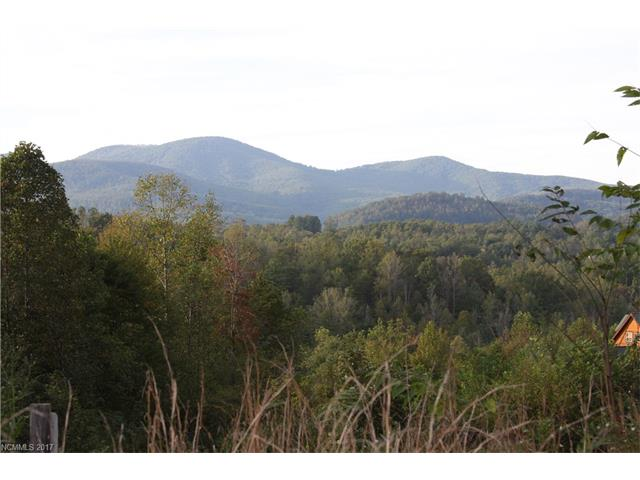 Lovely building lot in gated community with mountain views. Private 8-acre common area with creek. The pleasures of Chimney Rock, Hendersonville and Lake Lure are just minutes away.  Seller is responsible for recent road maintenance assessment at closing. Adjoining/additional lots for sale. Owner financing is available. Underground power in place.