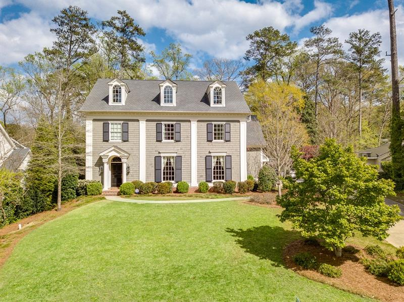 Outstanding Bill Baker design with four finished levels. Ideal cook's kitchen which opens to large family room and screened porch- both areas with fireplaces. Upper level offers handsome master suite with three additional en suite bedrooms. Third floor has additional family/rec room and guest bedroom and bath. Terrace level includes wine cellar, exercise room, family room with fireplace and flex space with full bath. Gorgeous heated pool. This special property won't last long!!