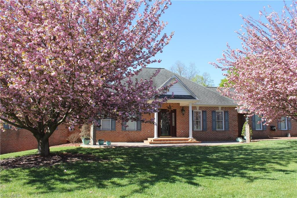 Custom built 2 BR, 2 bath all brick home on 59.57 acres. House features all oak hardwood floors, huge master bedroom with gas log fireplace, jetted tub and stand up shower. Full unfinished basement has wood-burning fireplace and five rooms already framed in, including kitchen with custom cabinets and living room. House overlooks beautiful spring fed pond. Cleared land for horses, balance wooded with good stand of hardwood timber and a nice stream. Has 3BR but current permit is for 2BR. Great new price!