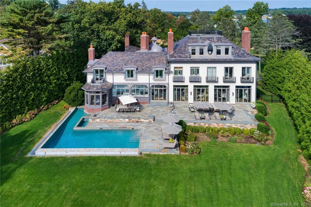 The crown jewel of Compo Beach, this stunning & architecturally significant home in the prestigious Bluewater Association enjoys commanding vistas of Long Island Sound & all of the beauty of the coastal area, both through glorious panoramic windows as well as from the myriad outdoor living & entertaining areas that seamlessly blend to create the lifestyle of your dreams. Designed by celebrated architectural firm Austin Patterson Disston & masterfully constructed by the lauded Tallman Building Co., the site was carefully selected for the blend of remarkable privacy & endless water views it affords. Crafted in the manner of the most important & gracious European estates, this dazzling residence presents the best of everything in a singular setting. Imported fireplace surrounds, tasteful decorative appointments, exquisite millwork, steel windows/French doors, arched doorways & superb flooring materials define the interior. The private quarters include an impressive waterview master suite, array of BRs to accommodate family, guests & domestic help - plus charming gathering spaces. The third level is a sensational recreational area, with stairs to a yet higher roof deck where the views are further amplified, there are even built-in binoculars to enjoy. The finished LL is another recreational haven incl oval wine cellar. Spanning the rear of the home are glorious water-facing terraces leading to the infinity edge pool and spa. 2 priv. assoc. tennis courts & private beach.