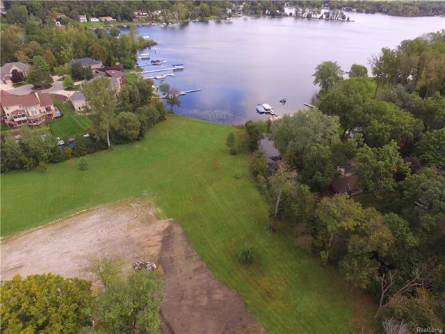 Imagine having your own island in award-winning Walled Lake School District! This land is a builders dream for unlimited creativity on 6.9 acres. Pull into beautiful Crystal Shores subdivision & you'll be greeted w/ a private entry to your very own island. Surrounding multi million- dollar homes, North Commerce lake, connecting to South Commerce lake & totaling an impressive 236 acres of private water w/ 22 ft depth. Space for multiple boat dock construction is available and most trees on the land have been cleared. Both septic existing and street sewer are available on this leveled dry land. Please check with the City of Commerce for any information pertaining to permits, zoning, and land survey. There is one home on the property which can be torn down and turned into your dream home. Ask agent about land contract opportunity