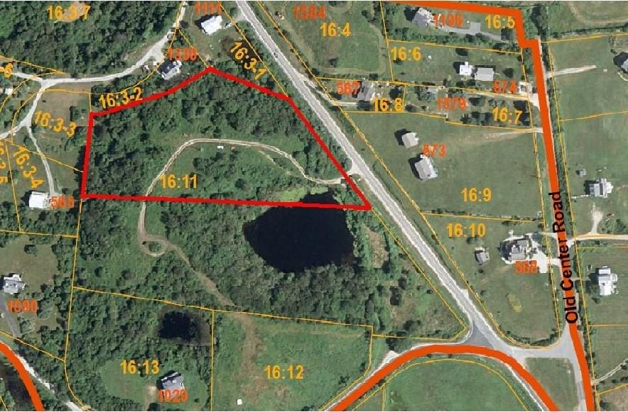 Enjoy privacy and views from this 4.22 acre parcel located off Center Road.  With vistas all the way to New Harbor and an easy location for access to town and beaches, this winning parcel has much to offer.  Year round fun and charm are added by Hulls Pond.  Watch the seasons change and enjoy the pond from summer to winter with great  fishing and  ice skating.  Affordable at $575,000