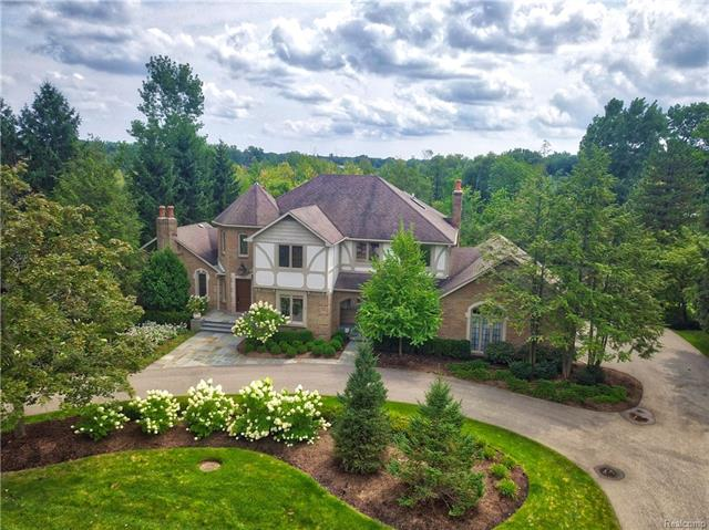 Completely remodeled & updated brick Tudor-style estate in desirable Chestnut Run. Set on over half an acre of peacefully wooded, pristinely landscaped grounds, on a prime lakefront lot. The ultimate bliss comes with access to your own private pathway & dock on beautiful Orange Lake! Exceptional craftsmanship is evidenced throughout this gorgeous 4 bedroom 4.5 bath home w/ new hardwood flooring & carpeting, custom built-ins, multiple fireplaces (in the living room, family room & lower level), a renovated kitchen, updated bathrooms, and a tastefully repainted wood-paneled office/library with exposed wood beams to match the neutral decor. Perfect for entertaining with a great layout & easy flow. The lovely cathedral-ceilinged master suite features a balcony, walk-in closet, dressing area, and luxurious bath with a jetted tub & separate shower. A spacious walkout lower level with a sauna & rec area, central air, circular drive, large rear deck & sprawling lawn enhance this dream home.