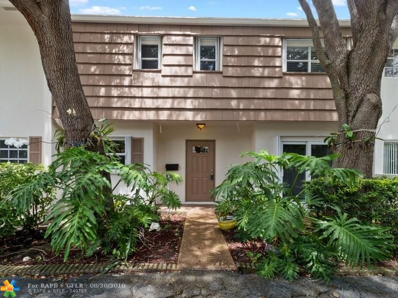 """Rarely available, completely updated, large 3 bed/2.5 bath townhouse at Palm-Aire Country Club. Private 30' terrace upstairs off the master suite and 2nd bedroom with amazing lake and yard view. Split bedroom plan. Ground floor has 30' patio as well. 2-car driveway. 3 mile lakefront walking path just off the yard. Modern kitchen has granite and stainless steel appliances. The home also features new A/C, a built-in electric fireplace, alarm, security cameras, full house water filter, washer & dryer, wood laminate, tile (no carpeting). All windows and doors are impact and/or have accordion shutters. Maintenance includes monthly pest control, Comcast high speed internet, HDTV and DVR. This home has it all! Sold """"as-is"""" with right of inspection."""