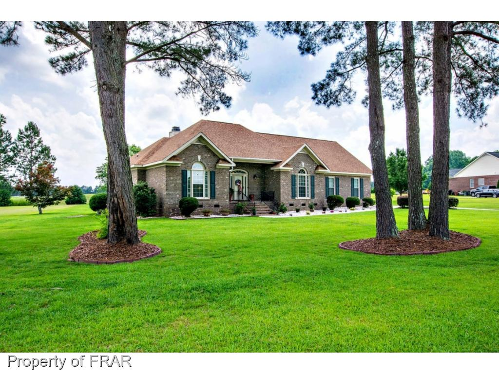 -Beautiful Brick Ranch of Bayonette  Golf Course, complete with is own golf cart garage! New roof, carpet and tile (2015) New windows vinyl fascia and screened porch (2013). Spacious and open floor plan! Guests bedrooms offers jack/jill bath. Master suite with his/hers closet and patio access. Master bath with jetted tub, and separate shower.