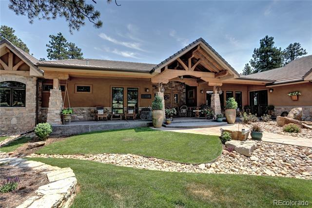 Welcome to this entertainer's dream, nestled on over 7 peaceful acres on a quiet cul-de-sac. The lot is gently sloping & lightly wooded, located only 12 minutes from 285 & C-470. You'll greet your guests on a massive timber framed front porch, leading into a beautiful foyer.  From there you will be overlooking an exquisite covered outdoor room to gather with friends and family. The gourmet kitchen includes high end cabinetry, Thermador appliances, an oversized refrigerator, warming drawer and a bake center, plus an enormous 11 ft. wet bar. The quality and amenities in this executive custom home are too many to mention. Just a few include: professionally landscaped yard w/ sprinkler system and water feature, a huge 3 car garage w/ ice maker, a separate oversized attached shop w/ overhead door, natural gas fire pit that comfortably fits 8, whole house Control 4 entertainment sys, future mother-in-law space and so much more. This property is impeccable and the perfect place to call home!