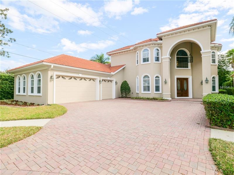 Elegant custom home in sought-after, guard-gated community of Tampa Bay's premier golf and country club AVILA. This Gorgeous Mediterranean home offers 4 bedrooms, 4 full baths, and 3 car garage with 4,156 sq ft of living space. The downstairs features a formal living room, dining room, study, Downstairs Master suite like no other with 3 additional adjoining rooms perfect for a nursery, exercise, media, or separate sitting area all overlooking the lanai and all with wood flooring. The custom built gourmet kitchen offers built in refrigerator, microwave, oven, warning draw, glass cook top with downdraft vent, and a second draw dishwasher all in stainless steel, a butler's pantry, and an extended counter wet bar area space with under counter ice maker, wine cooler, and refrigerator all open to the spacious family overlooking the fabulous lanai/pool area. IDEAL FOR ENTERTAINING! The kitchen and lanai are also pre-plumbed for Gas. Upstairs features a separate living/sitting area connecting the additional 3 bedrooms, and 2 full bathrooms. Other features include central vacuum, crown moldings, plantation shutters, surround sound, custom built in aquarium, paver pool area and driveway, and private back yard.