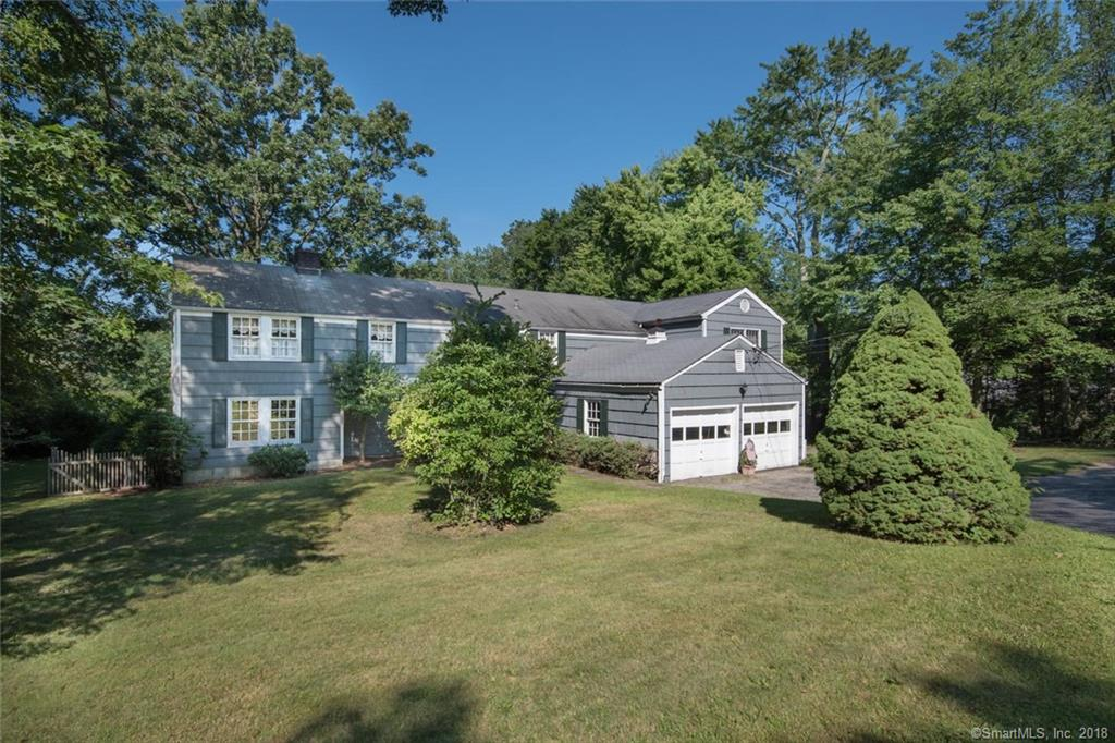 Seller looking for offers... Set on 2 acres just south of the Merritt, this 4,000+ sf Colonial features 4/5 BR, 3.1 BA & a new addition (2013). 1st Flr: living room w/fireplace, library w/built-ins, dining room w/fireplace, powder room, eat-in kitchen opening to the family room, laundry, mudroom w/side door to yard and 2-car garage, solarium & terrace. 2nd Flr: master bedroom w/sitting room & multiple closets (1 walk-in), master bath, den, 3/4 bedrooms & 2 additional baths. New addition has an ensuite bedroom & sitting room & there is a 2nd Flr laundry hookup. 3rd fireplace is on the unfinished lower level. House being sold ''as is.'' Renovate or re-build.