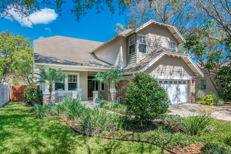"""South Tampa living at its finest.  This impressive home built by Devonshire in 2002 is the perfect home for you family.  Imagine sitting on your front porch enjoying coffee in the morning while you get ready to start your day!  Beautiful hand-scraped hardwood floors throughout the first floor greet you as you walk in.  There is a separate formal living and dining room along with an office with glass French doors.  The kitchen overlooks an inviting family room with a gas fireplace along with vaulted ceilings and French doors going outside.  The master bedroom is on the first floor with plenty of space and walk in closet.  As you head upstairs there are 3 additional spacious bedrooms and 2 baths and an impress theatre room.  This is something that will impress your friends with 8 reclining theatre chairs and a bar area in back with additional seating.  Watching your favorite movie feels like you are in the movie theatre with a 120"""" screen and top of the line equipment!  Conveniently located in the heart of South Tampa, you are minutes away downtown Tampa, Tampa International Airport, sports arenas, shopping and walking distance to the YMCA.  Don't let this one slip away.  Call for your private showing!"""