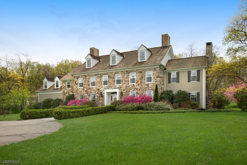 2017 Tax Assessment Reduction to $1,050,000    Classic Colonial Revival Stone & Clapboard w/wood shake roof deep set on premier 8+level acres with 6700 sq ft of stately grace & charm w/raised panel
