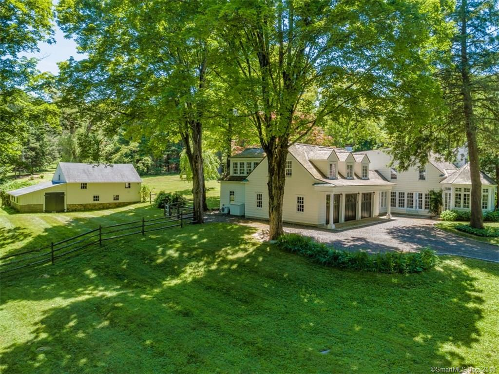 Fall in love with this expanded 1923 Gracious Cape sited on 3.27 acres with level lot and mature trees. A lovely property on beautiful scenic Marchant Road. This well maintained home radiates warmth. It includes 5 bedrooms and 5 full baths. The elegant large Living Room with wonderful light has views of the expansive level lawn.  The cozy Dining Room with French doors to a slate patio. The large bonus room has a full bath and is separate from the main house and may be used as a guest suite, au pair or office. Salt Water Pool... lovely cabana with small kitchen, full bath with cozy seating area. Barn with fenced paddock. Just down the road from bucolic New Pond Farm. This could be your country compound in desirable West Redding!