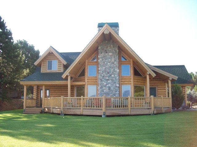 Log home over looking Cascade Lake, adjacent to Golf course, just a few minutes to public boat ramp, city conveniences and activities. Master on main level, total of 3 bdrm, 2.5 bths.  Large open kitchen with granite counter tops and lots of alder cabinet space, formal dining room.  Spacious living room with floor to ceiling stone wood fireplace. Separate den, and additional bonus room with pool table and T.V. room. Finished 3 car garage with storage, paved driveway, hot tube, sprinkler system and alarm system. This fabulous home has it all and is ready for you to move into. Some Furnishing are negatable separately from real estate.