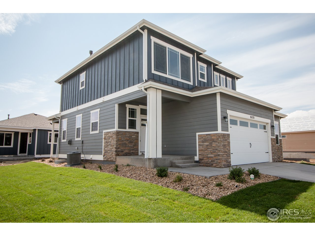 Rare opportunity to own a brand new Baessler Home without the 6-month wait, home is move in ready!  This stunning London has plenty of space for everyone.  The smart design allows for open entertainment on the main level both inside and out.  The second level features 3 bedrooms, 2 baths, and laundry. This home is full of upgrades including flooring, quartz counter tops, a custom fire place and much more!  With mountain views and close access to the Poudre Trail, this home is a must see!