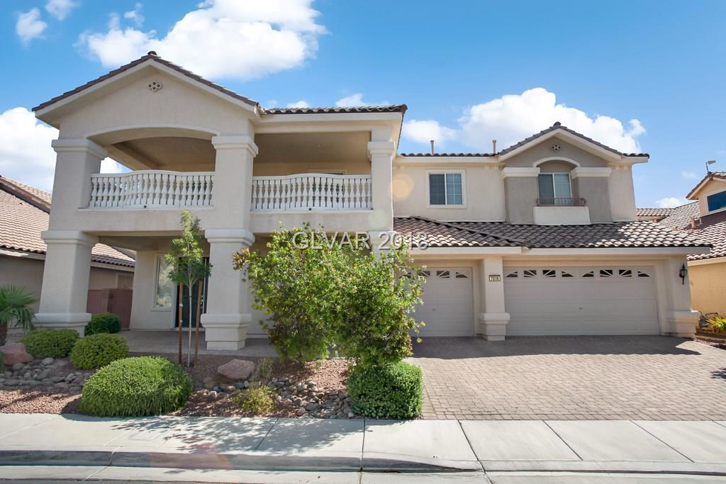 Beautifully upgraded home in gated Aliante community. Features include new carpet, huge living spaces, downstairs bedroom and full bathroom, laundry room with sink, loft, large balcony, bedroom/theater room, master suite includes balcony with mountain views, dual sided fireplace, dual walk in closets and separate office. Backyard is entertainers dream with two built in BBQs and custom saltwater pool with waterfalls and removable fence.