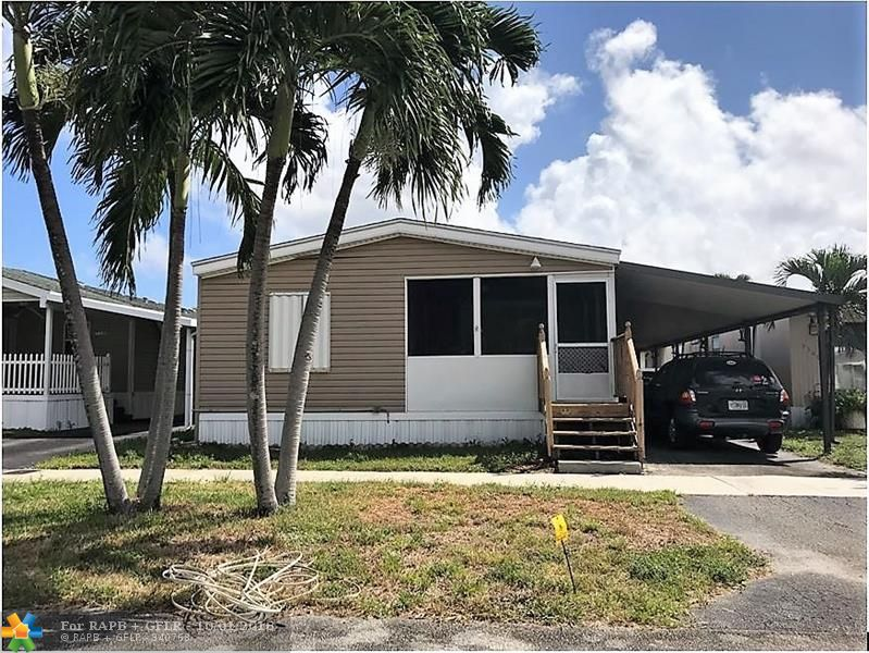 Oversized 3/2 doublewide with carport - screened in patio - shed - -one of the largest homes available in Ravenswood - -accordion shutters  - - priced right for quick sale - -truly a must see...........